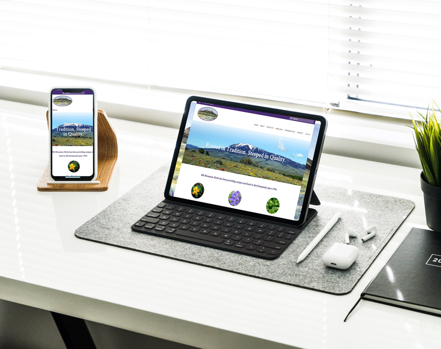 tablet and phone on table showing design for Elk Mountain Herbs website